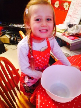 Mini KAT ready to make fairy dough with apron, bowl and the needed ingredients of cornflour, food colouring and hair conditioner. We also added some glitter for extra fairyness.