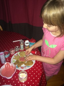 Decorating our Christmassy White Chocolate and Ginger Biscuits
